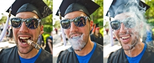 Young man celebrating his university graduation with a cigar.