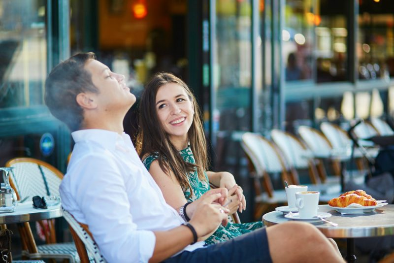 Image of couple smoking in a restaurant.