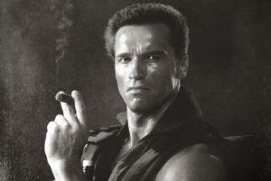 Image of Arnold Schwarzenegger smoking a cigar.