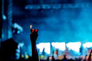 Image of concert member lighting a butane lighter.