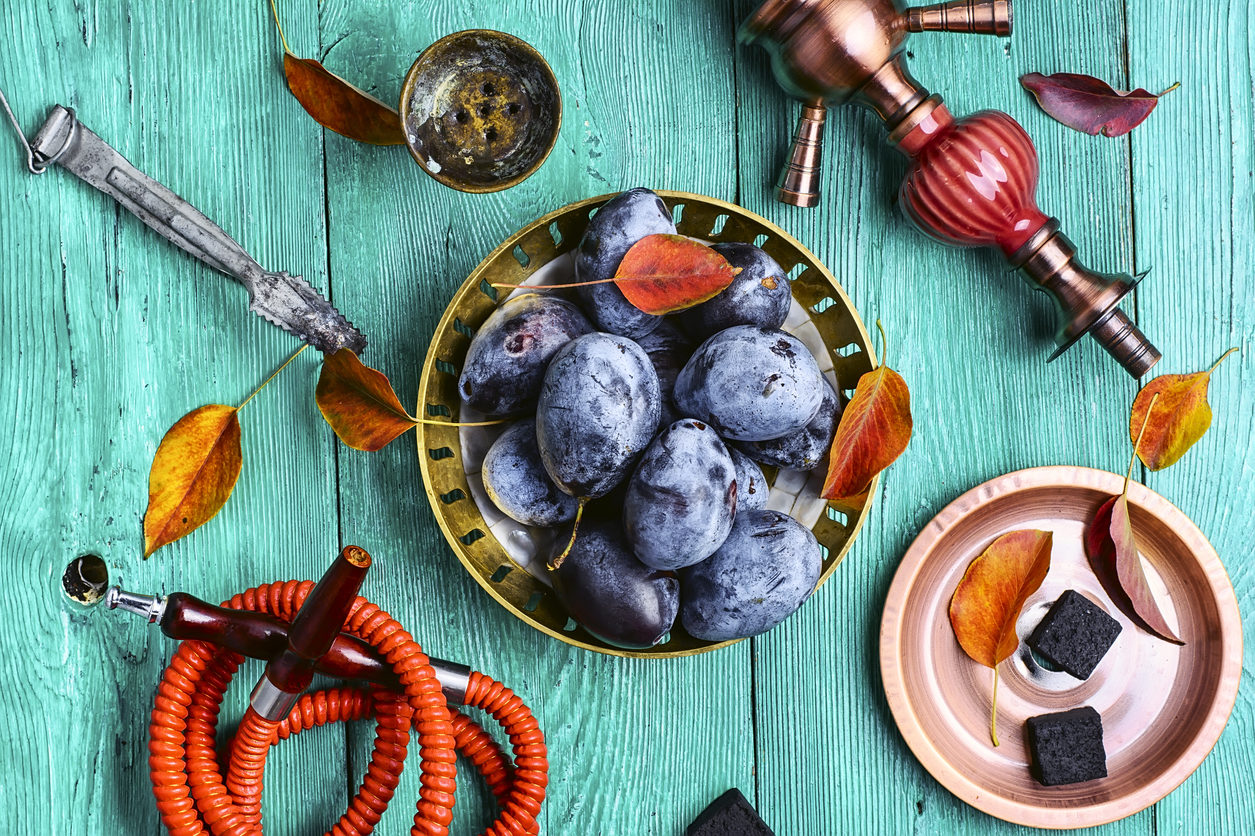 Smoking hookah accessories and tobacco with the taste of autumn plums