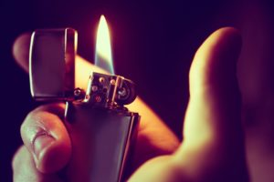 an image of a hand holding the best butane lighter