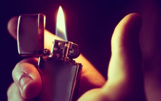 an image of a hand holding the best butane lighter