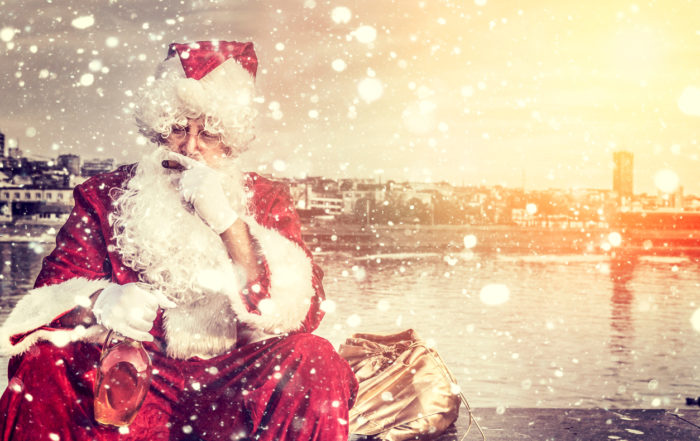 Santa Claus with cigar and bottle of brandy