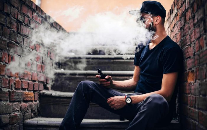 Men with beard vaping